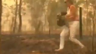 大規模火災に巻き込まれたコアラを救う女性